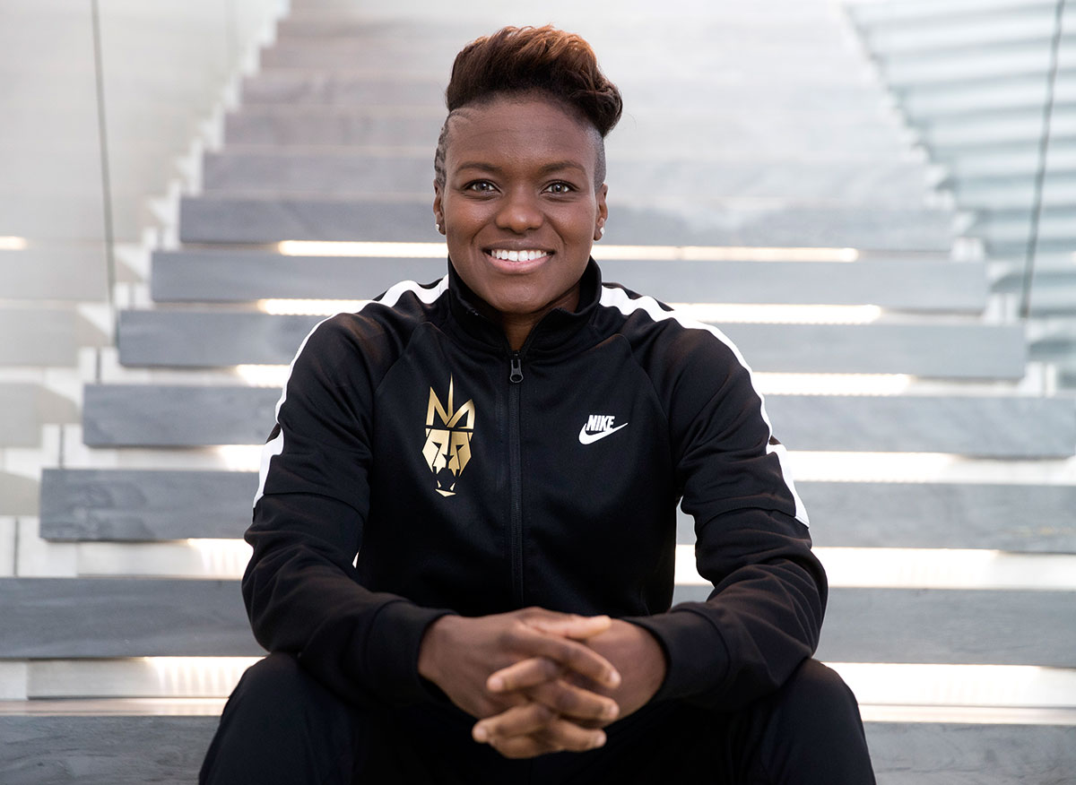 Portrait of boxer Nicola Adams sitting on steps