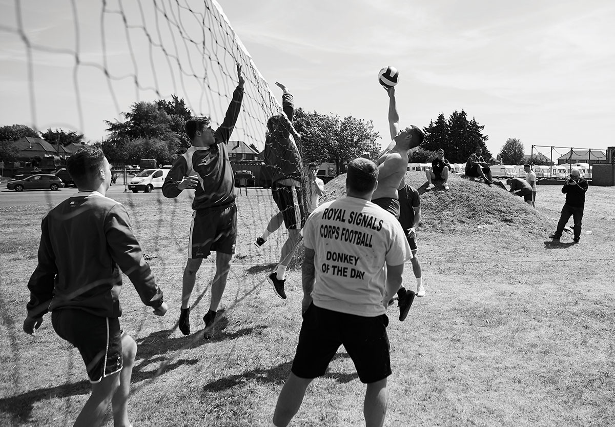 British Army's Royal Signals Corps Football team playing volley ball