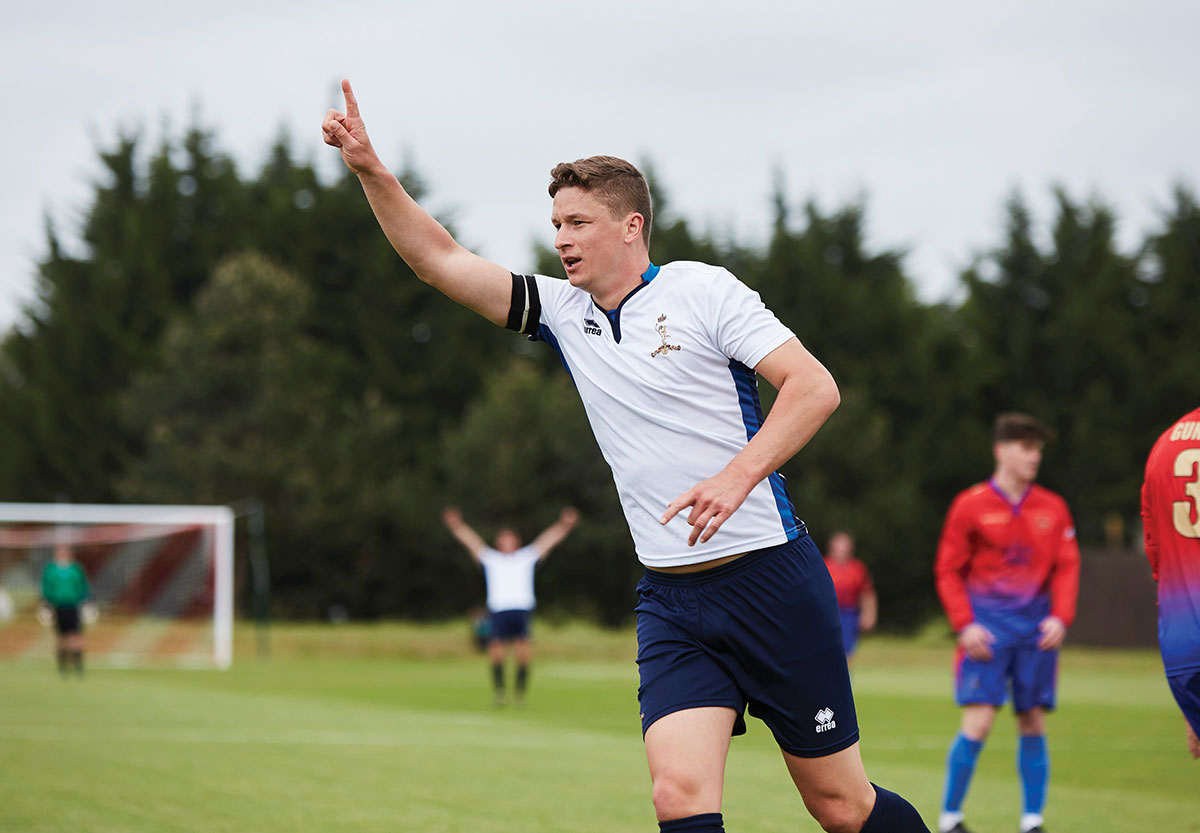 Ryan Paddock celebrates scoring for the British Army's Royal Signals Corps Football team