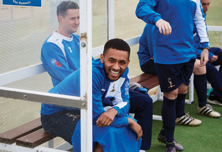 British Army's Royal Signals Corps Football team players joke while warming up
