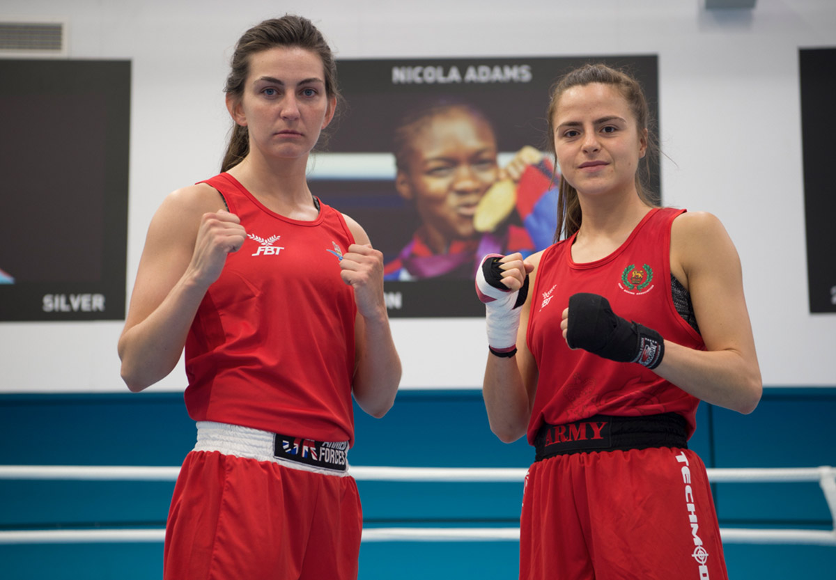 Team GB boxers and British Army Gunners Karriss Artingstall and Tori-Ellis Willetts pose in the ring at the English Institute for Sport